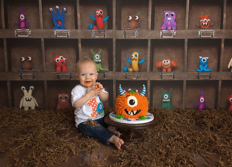 monster themed first birthday photo session cake smash in olympia