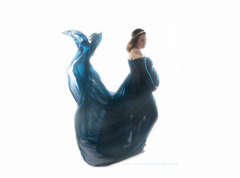 gorgeous-pregnant-mother-wearing-dreamy-blue-dress-for-her-maternity-photo-session-in-olympia-wa