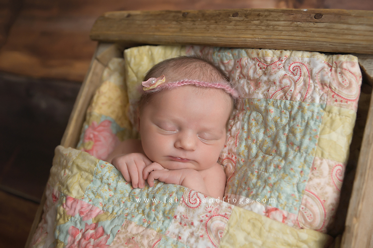 sweet-baby-asleep-in-quilt-at-her-newborn-photography-session-in-olympia-washington