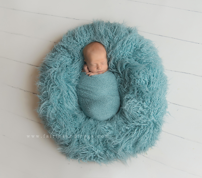 newborn-photo-session-with-seafoam-pillow-in-olympia-washington