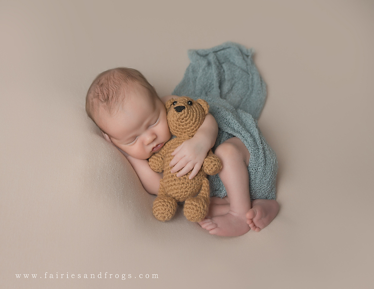 newborn-with-blue-blanket-and-bear