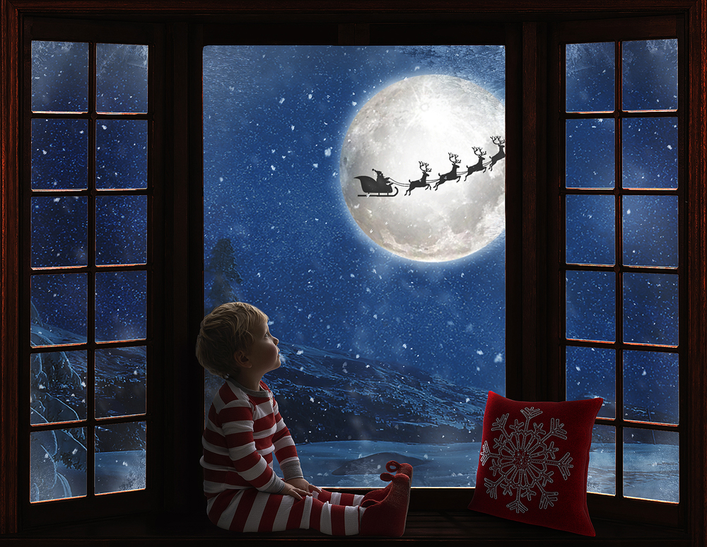 Magical toddler Christmas photos with a child watching Santa and his reindeer under the moonlight