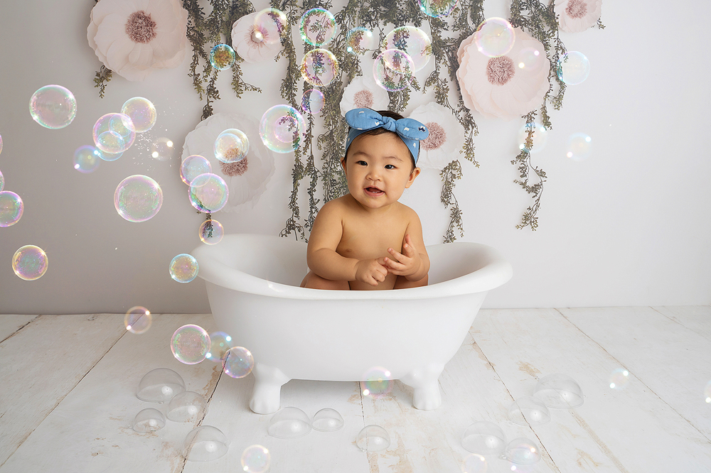 Baby's first birthday photoshoot in a bath tub