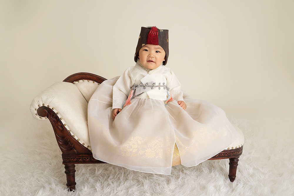 Baby's first birthday in a traditional outfit