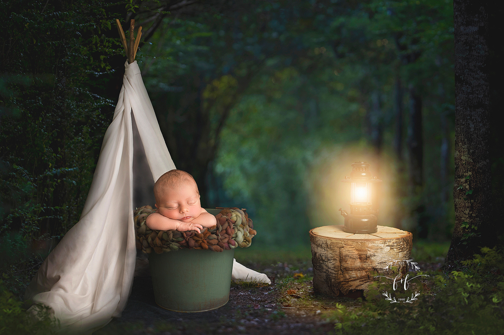 Newborn photo with a camping theme