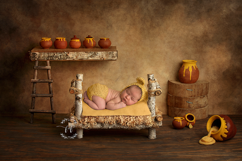 Winnie the Pooh newborn photo with honey jars and cute wooden bed